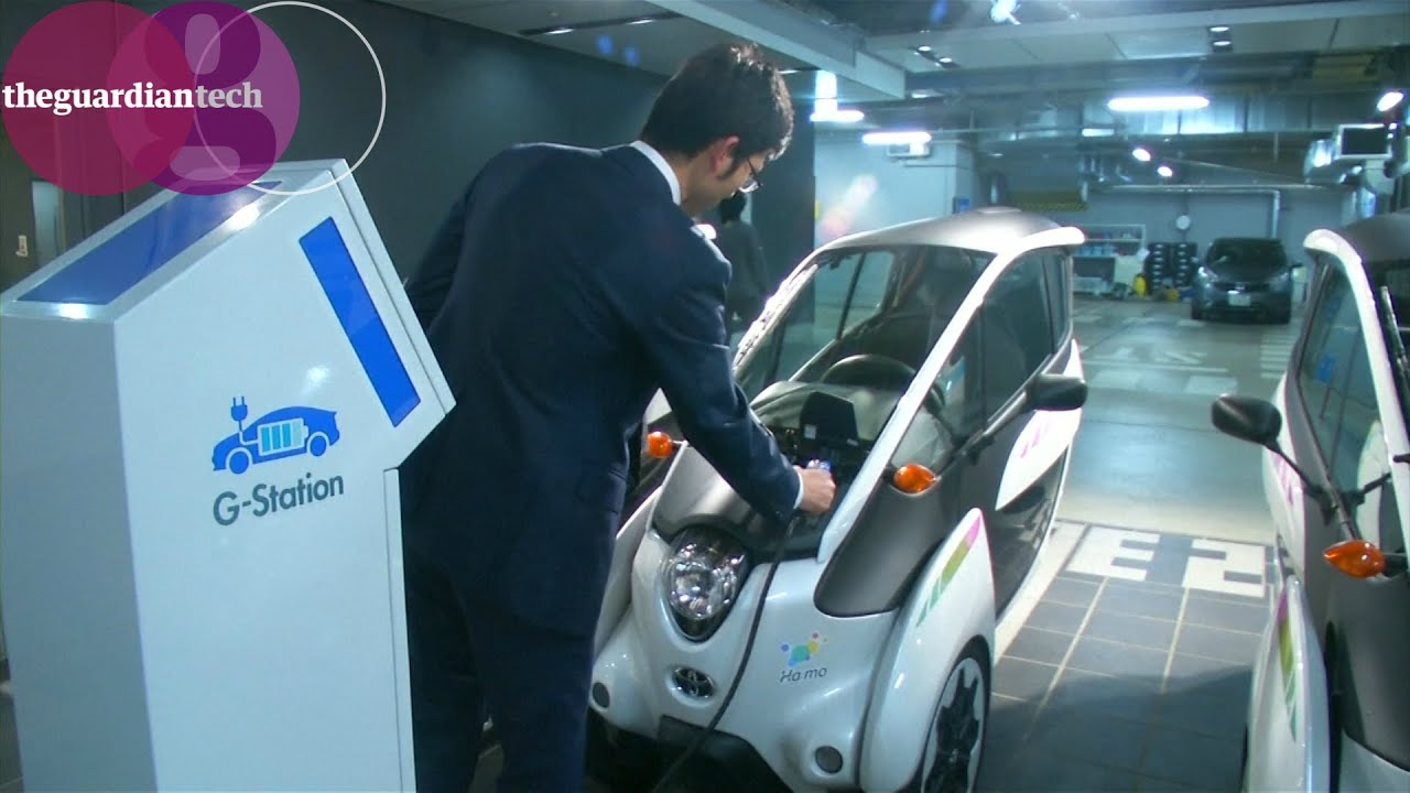 Toyotas Electric Three Wheeled Car Takes The I Road To Combat Toyota Shows Iroad A Fullyenclosed Tilting Tokyos Pollution