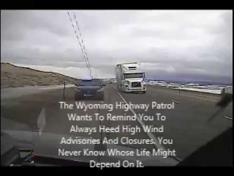 Wyoming wind gust blows semi truck on top of police car
