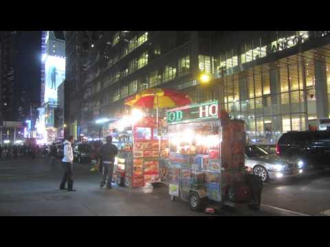 Street Scenes of Midtown Manhattan at Night.