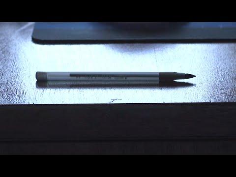 Pen rolls off a desk