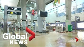 Hong Kong protesters target airport, clash with police