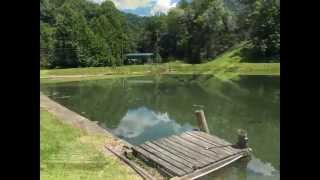 beautiful private log cabin home house for sale on 10 acres a pond in the southern wv mountains