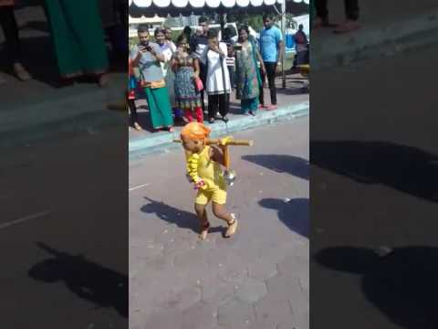 "Small boy taking ""paal Kavadi"" and dancing during 2017 Malaysia Thaipusam"