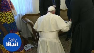 Pope Francis kneels to kiss feet of South Sudan rival leaders