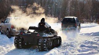 Что лучше всего едет по снегу - колесный вездеход на гусеницах