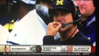 "Michigan football coach Jim Harbaugh eating his ""BOOGERS"" during a game."