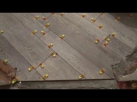 Раскладка плитки под паркет в ванной с использованиям СВП