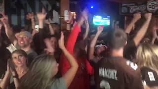 Browns fans celebrate win - Bud Light victory fridge