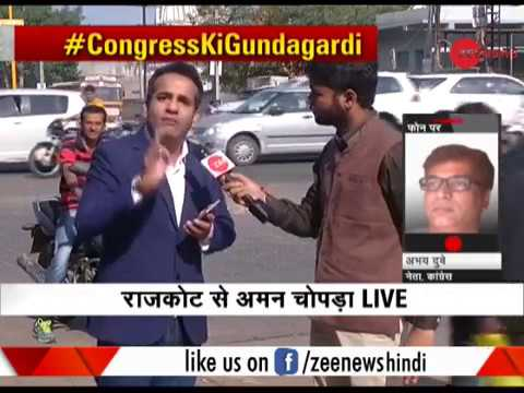 Zee News journalist attacked by Congress workers in 'Game of Gujarat' event