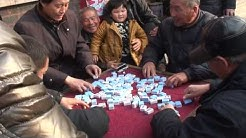 mahjong game played on a street in Qufu China