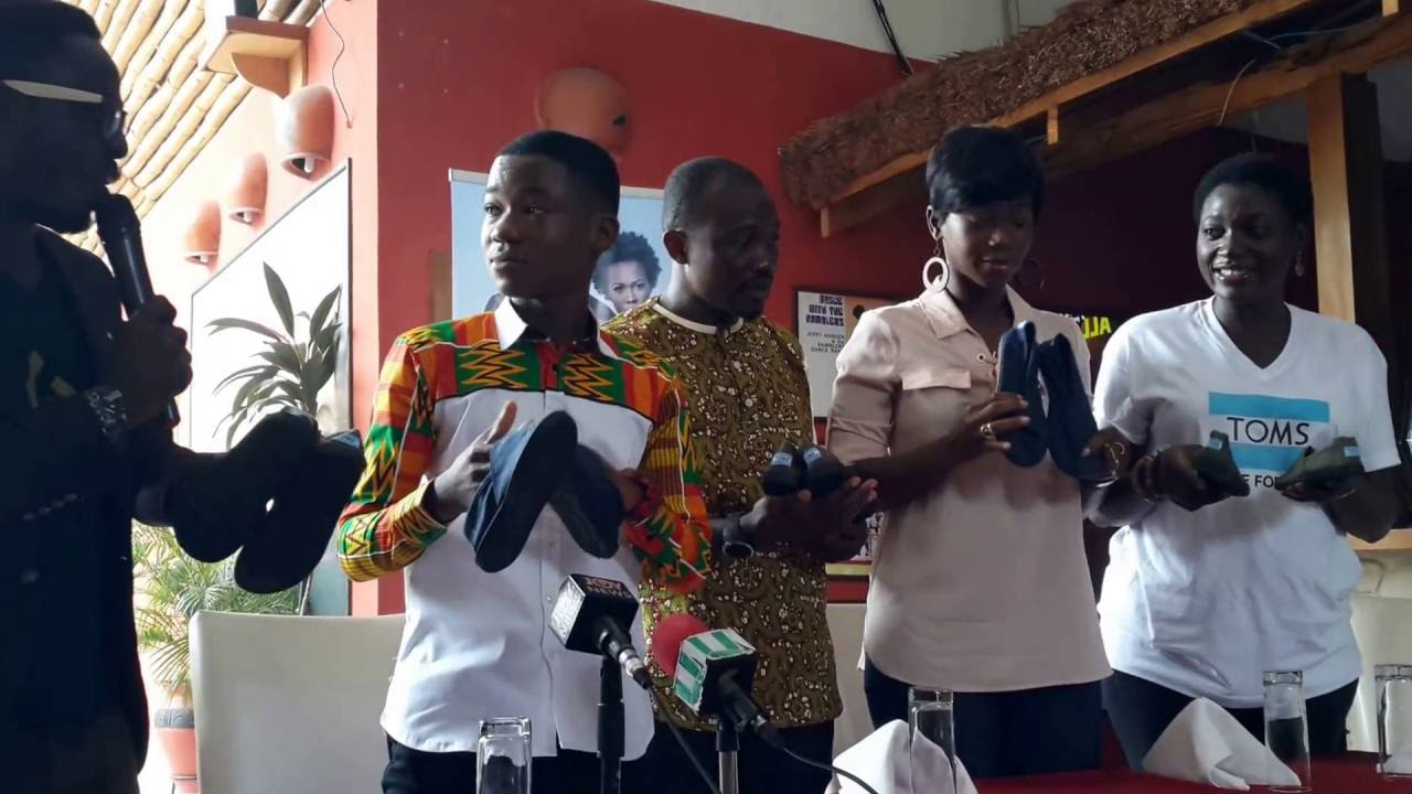 Abraham Atta donating Tom shoes