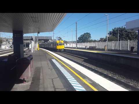 Queensland Rail's newly refurbished EMU52 running express through Albion station.