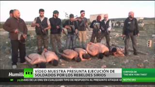 Repeat youtube video Un vídeo muestra la brutal ejecución de soldados sirios a ma