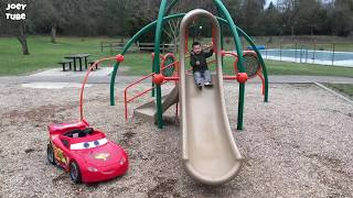 Joey drives Lightning McQueen Ride on at the park