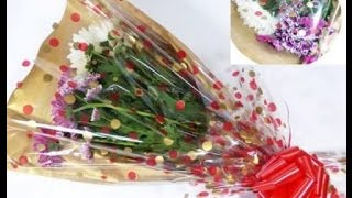 Gift wrapping video - How to gift wrap a bunch of flowers by Neelam Meetcha