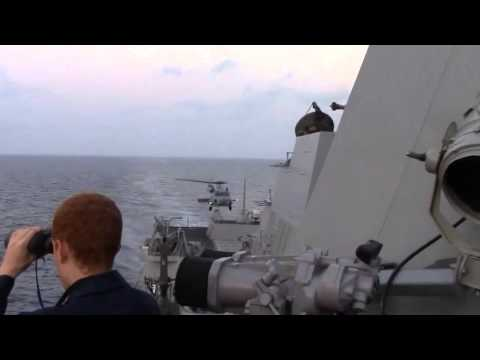 U S  Navy Helicopter Takes Off from USS Kidd DDG 100 in Search of MH370