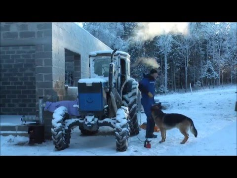 Starting an air cooled tractor in winter. Featuring T-40AM Russian tractor