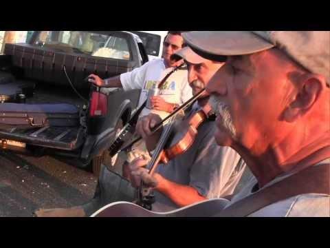 Bluegrass musicians play into the summer night