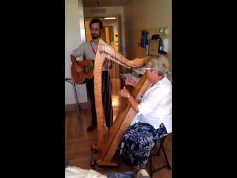 Live healing music at the bedside for patient in the hospital - harp and guitar.
