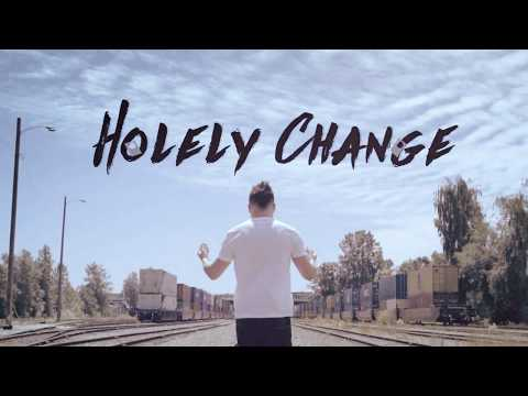Holely Change (DVD and Gimmicks) by SansMinds Creative Lab