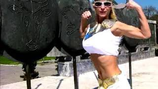 Hot Fitness Woman flexing biceps in Ancient sexy costume