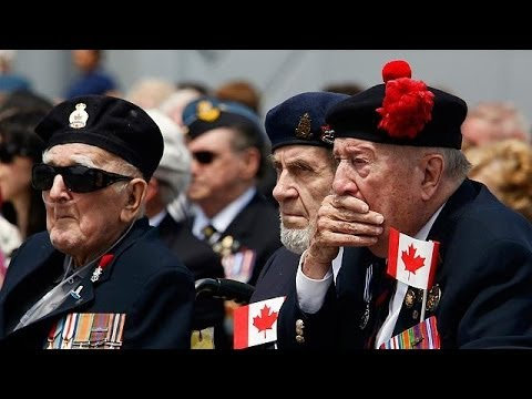 French president addresses veterans and leaders at D-Day ceremony