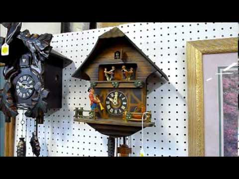 German / Swiss cuckoo clock with music box and animated figurines.