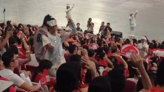 NDP crowd learns to song sign at NDP 2016