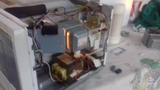 LM assistencia técnica consertando microondas LG  q estava em curto