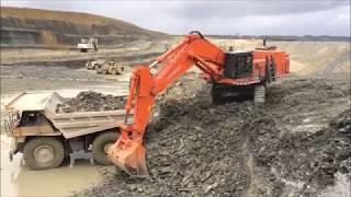 HITACHI EX 1200 loading Caterpillar Cat 777  [1080p]