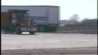 Experiment: What happens when a dump truck going 50mph hits a military-grade concrete barrier?