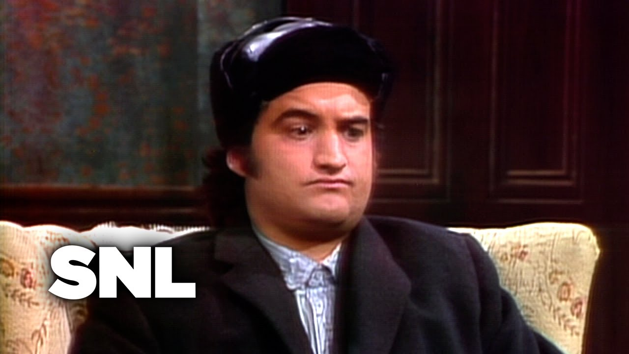 Saturday Night Live's Very First Sketch: Watch John Belushi Launch SNL in October, 1975