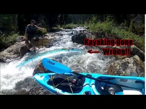 Noob Kayakers have a BAD Day on their First River....  This Kayak is REALLY stuck!!!