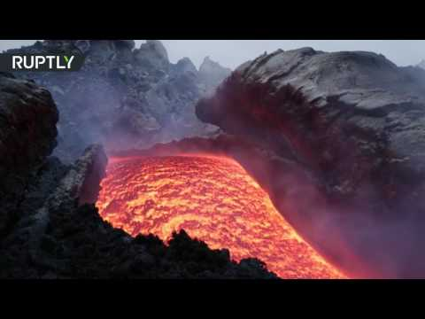 Rivers of hot lava flow onto slopes of Mount Etna after eruption