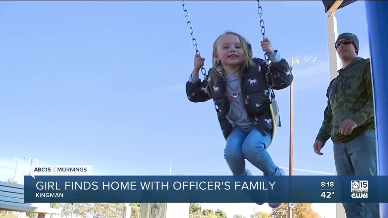 Kingman officer adopts girl after case of abuse