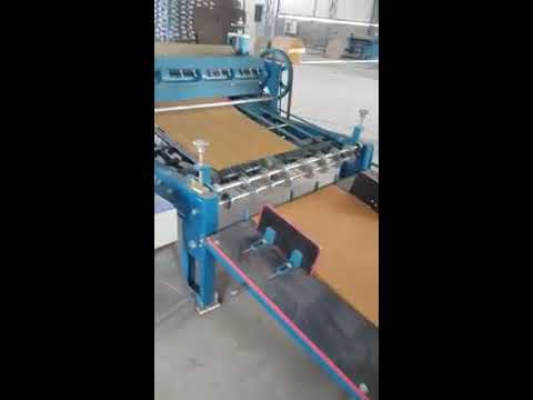 Paper reel to sheet cutting machine with jogger