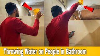 throwing water on people in bathroom | Taking Pictures in Bathroom Prank | prakasg peswani prank |
