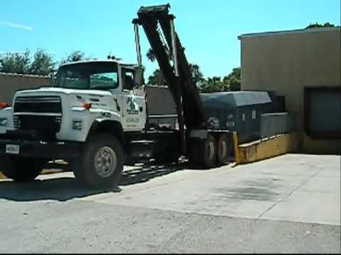 Roll Off Hoist Garbage Truck In Action 10 4 11 Youtube
