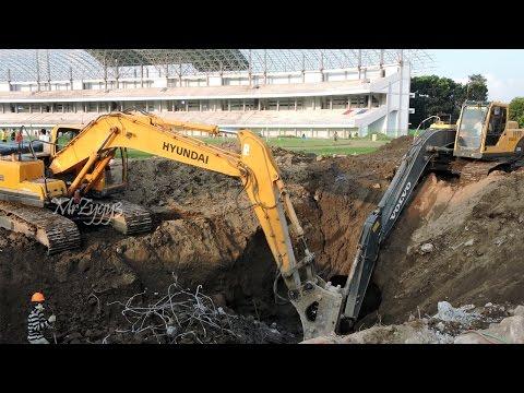 Excavator Digging Concrete Tower Foundation
