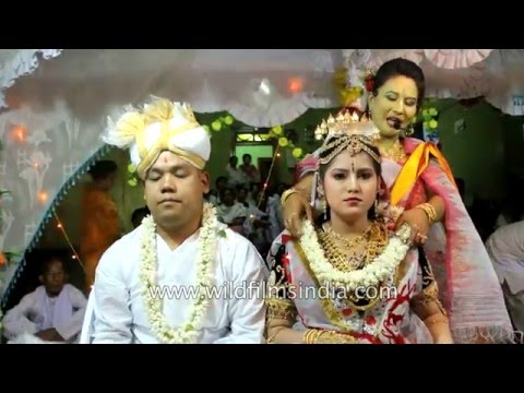 Manipuri wedding - Bride and groom sit at wedding mandap