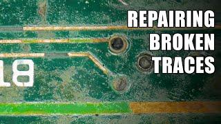 Repairing broken traces on a circuit board
