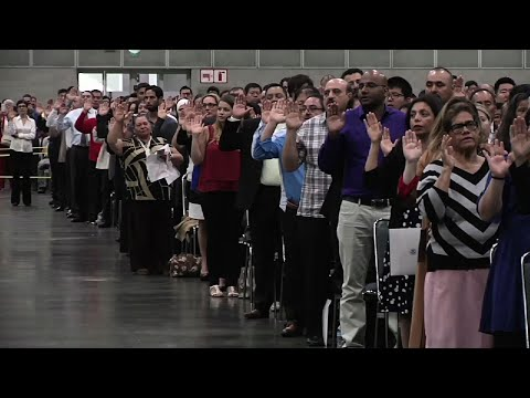 New Citizens Greeted With Trump Video