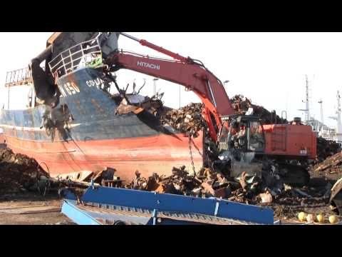 Hitachi Zaxis 670 LCH With HKS Scrap Shear Cutting Up A Ship