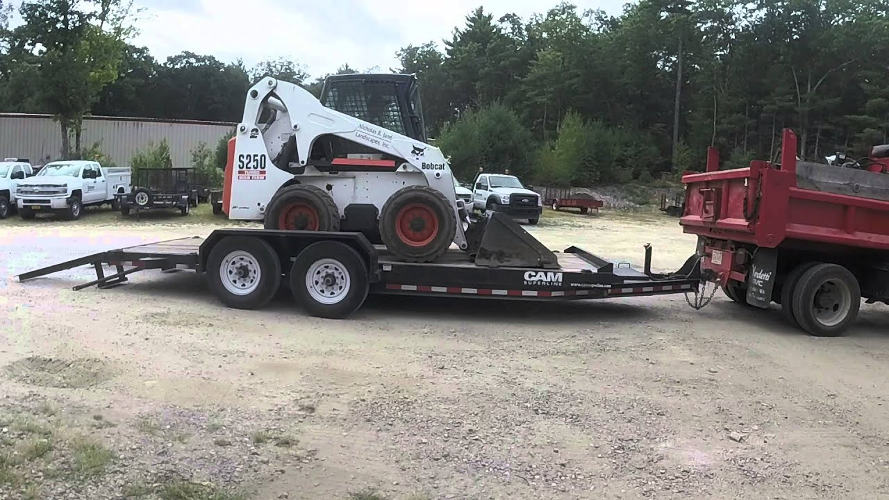 Show Me A Picture Of A Bobcat >> Loading and Unloading Bobcat Skid Steer on Trailer - YouTube