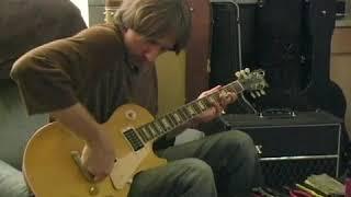 How to Raise the Bridge on a Les Paul Guitar