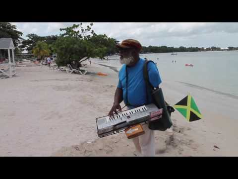 """Jamaican Music, """"One Love,"""" Sung By Jamaican Musician Playing Music With One Hand"""