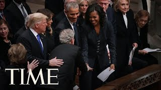 George W. Bush Slips Michelle Obama During His Father George H.W. Bush's Funeral | TIME