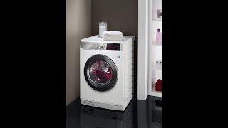 обзор стирально-сушильной машины AEG L99695HWD