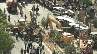 Digger overturns Jerusalem bus in suspected attack