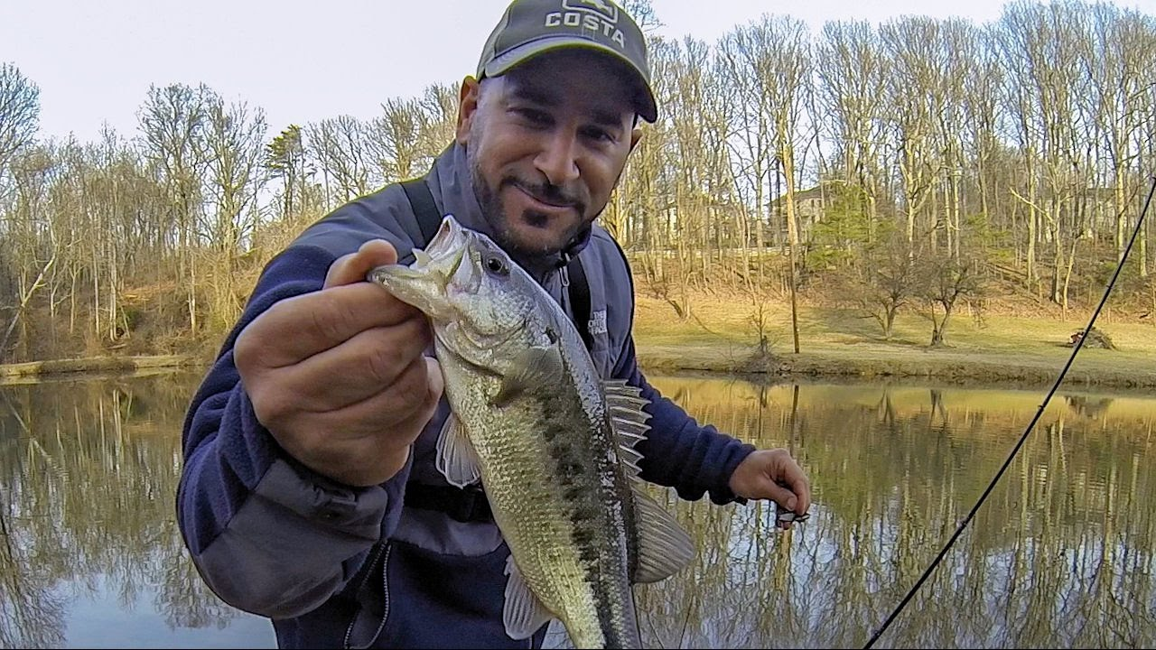 Winter bass fishing an icy cold pond with a blade bait for Bass fishing in maryland